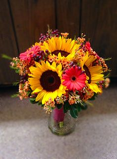Fall bridal bouquet with sunflowers, gerber daisies, wax flower and hypericum berries