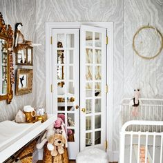 At the Manhattan apartment of designers Nate Berkus and Jeremiah Brent, diapers and supplies are all within easy reach in daughter Poppy's nursery.