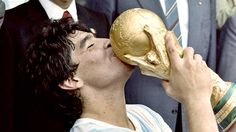 Argentina's Diego Maradona embraces the World Cup following his side's 3-2 victory over Germany in the 1986 World Cup final in Mexico.