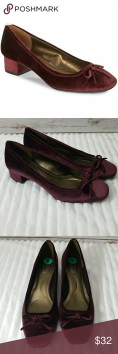 Bandolino Xenica Sangria Velvet Shoes. Beautiful shoe. Never worn.  Bandolino Xenica pump.  Man-made upper with bow-tie detailing at vamp. Slip-on design.  Softly squared toe. Lightly-padded footbed.  Wrapped, moderate block heel.; Imported. Measurements: Heel Height: 1. 1 4 in ; Brand new. Never worn. Sangria Velvet.  Block heel. Bandolino Shoes