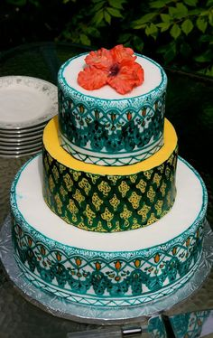 This cake it too good to eat! It has all the traditional Arab/Moroccan detailing #wedding #cake #turquoise #blue #yellow #tasty