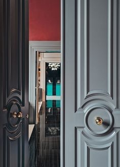 love the color of these doors against a bright orangy red in the room beyond. Office color idea?
