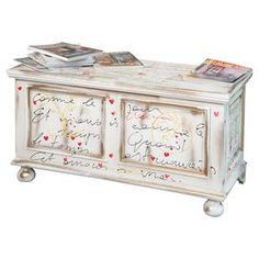 Perfect for housing spare linens at the foot of your master bed, this wooden blanket box features a French script design. Arrange alongside floral fabrics, bare wood floors and a sunny palette for a cheerful country scheme.  Product: Blanket boxConstruction Material: WoodColour: White, black and redFeatures:  Lift topTypographic print9 kg Dimensions: 51 cm H x 99 cm W x 44 cm D