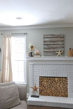 Love the sliced wood in the fireplace.  Just Love It!