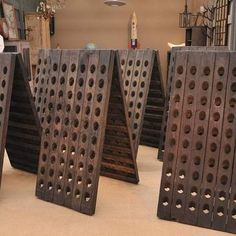 French Champagne Riddling Racks - The bottles are turned regularly and brought gradually to a more vertical position to gather the sediment in the top. Riddling used to all be done by hand, but is now mostly automated.