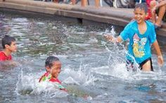 Children having fun at the Medan Merdeka Fountain, Jakarta