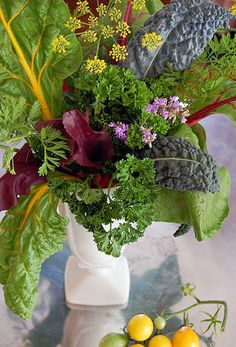 I love this vegetable centerpiece from The Art of Doing Stuff with beet greens, swiss chard, anise flowers, lavender, parsley, carrot tops, and of course, kale.