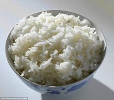 Scientists have discovered that adding coconut oil to rice and cooling it in the fridge for 12 hours cuts the calorie content in half