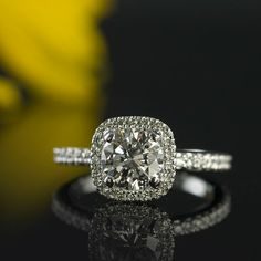 Round diamond in a cushion shaped halo engagement ring