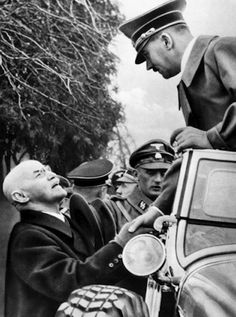"""Leopold Poetsch shares a moment with Adolf Hitler in 1938. Poetsch was the Führer's geography and history teacher, and Hitler later attributed him with having had an important influence on his political mindset:""""For who could have studied German history under such a teacher without becoming an enemy of the state which, through its ruling house, exerted so disastrous an influence on the destinies of the nation. And who could retain a loyalty to a dynasty ..."""