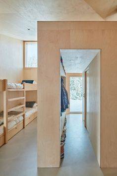 Internal surfaces are predominantly lined in pine plywood, which is treated with lye and white oil to create a warm and bright appearance throughout the house.