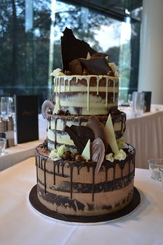 white and milk chocolate drip naked wedding cake