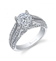 This beautiful 18K white gold diamond engagement ring features a 1.50 carat Round brilliant diamond. This diamond engagement ring features a split shank setting with round diamonds streaming down the you.)