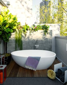 this is a high-end designer rm which you can easily adapt to a doable budget. Formular;1=TUB; from Habitat/ resale/outlet type stores.2-If U require flooring, tj max usually has bamboo or teak bath mats.,in pic. there is outdoor grade carpt.under bamboo, very inexpensive for 10x12ish pc. 3=pvt.WALLS; MDF boards in graduated heights, painted w/good outdoor paint 4=PLANTS;easy care succulents w/ a tropical feel. 5=keep it a monochromatic color palette the less busy, the more refined it will…