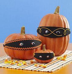 masked pumpkins No-Carve Pumpkin Decorating Ideas