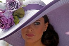 Tamara Sorreoo, from Austin, Texas, shows off her Derby hat before the 137th Kentucky Derby horse race at Churchill Downs Saturday, May 7, 2011, in Louisville, Ky. (AP Photo/Denis Paquin)