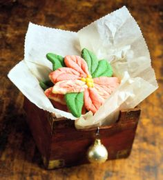 Shape tinted dough into petals and leaves to make these lovely cookies look like poinsettias. In spring, shape the dough into the shapes of spring flowers.