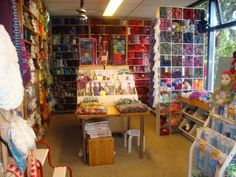 wool shop in Bergen, NL Love the colour groupings on the back wall