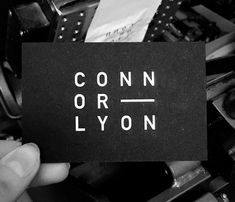 White foil blocking on Ebony black Colorplan Paper.  Business cards printed for Connor Lyon, by Dot Studio