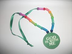 God's promise necklace.  A craft made from a laminated card stock medallion, with plastic straw pieces and beads strung on to a ribbon. The boy's version uses fruit ring cereal.  Good for any lesson that involves a Bible character holding on to God's promises.  Used today for Joseph in prison. Joshua 1:9