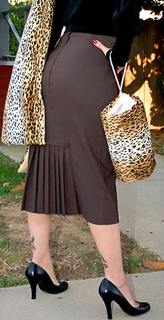 Love the pleating detail on this skirt!  (Not real fond of the leopard accents, though...)