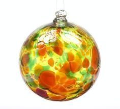 Kitras 6-Inch Calico Ball, Autumn Leaves by Kitras Art Glass. Save 27 Off!. $20.41. Can be used outdoors and indoors. Recycled glass. Unique Gift. These beautiful hand-blown glass window ornaments are traditionally known as symbols of friendship. They sparkle in the light the way a good friend brings sparkle to your life. Colors swirl and mingle across the surfaces of each ball enhancing each other just as the talents and varied personalities of our friends bring color to your l...