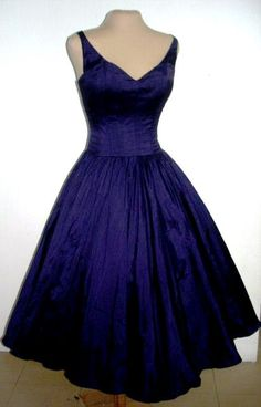 A sexy yet elegant 50s style cocktail dress in gorgeous deep blue satin