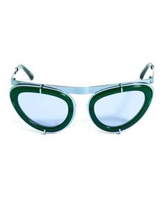 Linda Farrow for Erdem's futuristic cat-eye sunglasses are the perfect choice to really make a statement.