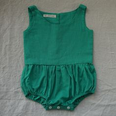 Nothing better than chubby baby limbs in the summer! Loving this emerald green Lois Playsuit. #estella #baby #fashion