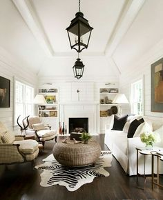 Black and white neutral living room space with a zebra hide rug feels modern and eclectic.