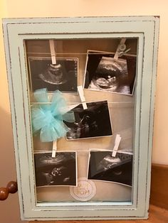 Baby Shower Shadow box with ultrasounds pictures and baby shower themed trinkets.
