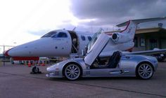 JetSuite Pilot Scott Walden took this picture of a Spyker Spyder next to our Phenom 100 in Houston, Texas. Talk about traveling in style and door-to-door service! Skip the miles on your car (and the travel time!) and charter a private jet. Drivers Ed, Private Jet, Time Travel, Travel Style, Pilot, Aviation, Planes, Car, Wheels
