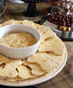 """A Puppy-Themed Party - mom.me  dog bone cookie cutter to slice shapes from flour tortillas. She then brushed the """"bones"""" with olive oil, sprinkled on salt and garlic powder and baked at 300 degrees until they got crispy. Served with hummus, they're a great snack for kids and adults."""