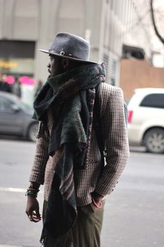 Love that oversized scarf and makes his entire look unique and interesting