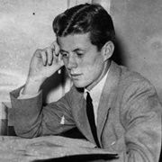 John F. Kennedy sits and studies at his desk at Harvard, c. 1939.