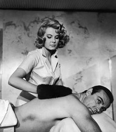 Scottish actor Sean Connery gets a massage from Molly Peters in a still from the James Bond film, 'Thunderball,' directed by Terence Young, Get premium, high resolution news photos at Getty Images James Bond Books, James Bond Movies, Roger Moore, Sean Connery James Bond, Service Secret, Scottish Actors, Getting A Massage, Bond Girls, Actrices Hollywood
