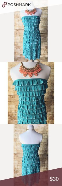 """Gorgeous Turquoise Strapless Ruffled Dress Fun & flirty, strapless dress with ruffled layers in turquoise with a whitish stripe on bottom of each ruffle. The dress is lined. It is missing a size tag, but I feel it's medium/large. It has quite a lot of stretch. I am a small/medium (36B, 27/28 in jeans) and it is a bit big on me. I have included measurements. These are straight measurements without stretching at all. Like I said, it has ability to stretch more. Waist: 32""""; Bust: 32"""" (but a lot…"""