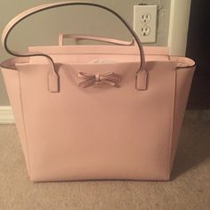 FINAL DROP kate spade sawyer street large tote nwt Beautiful Kate spade bag! Has cute little bow in front. Color is pale pink with pink straps. Large size and very roomy with inside zippered compartment. New with tags and paper. No trades or LOWBALLS, reasonable offers accepted kate spade Bags Shoulder Bags
