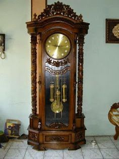 Melayani pemesan Mebel furniture kayu jati: Almari jam hias 4