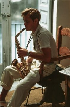 "Jude Law playing saxophone as Dickie Greenleaf in ""The Talented Mr. Ripley"" (1999)."