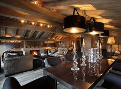 chalet interior | The lighting  up in the beams is an outstanding idea. I also like fireplace lighting. Highlight rustic elements