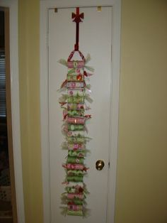 Advent calendar out of toilet paper rolls, scrapbook/wrapping paper, & ribbon. Cute!