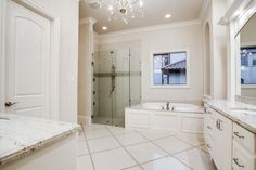 For Sale: 3680 Country Walk Ct in Frisco's Beautiful Gated Community, Newman Village. Contact us for details. Master Bathroom with Elegant Updated Features and Design.