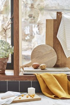 Little kitchen helpers that are big on style: Olive, mango and oak accessories fit the decor, no matter the decor.
