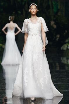 Capelet sleeves on this #wedding dress from Pronovias, 2013