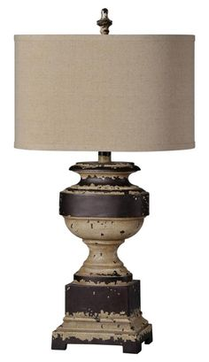 Tradition with a twist can be seen with this heavily distressed cream and dark brown finish. The Donna lamp blends traditional with a touch of contemporary maki Farmhouse Light Fixtures, Farmhouse Lighting, Rustic Lighting, Table Lamp Sets, A Table, Farmhouse Style Table, Nebraska Furniture Mart, Light Table, One Light