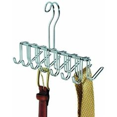 Chrome Belt Holder   Top Features include: Quality Chrome finish 14 hooks for holding lots of accessories Dorm Space Saver Hangs from your closet rod