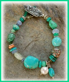 Enchanted Butterflies bracelet...  IN THE MIX Comprised primarily of Kingman & Tibetan Turquoise with bright splashes of color: Chalcedony, Tanzanite, Chrysoprase, Mexican Fire Opal, Variscite, Green Onyx, Lemon Topaz, & Chrysocolla. An authentic African Trade bead too.  SIZING IT UP Bracelet measures...........7.5 inches  An Original Handcrafted Bracelet by Cathy Dailey