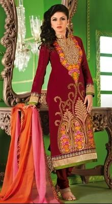Maroon Embroidered Bhagyashree Chanderi Silk Chudidar Party Dress Dress like Bollywood star Bhagyashree in this maroon embroidered Chanderi silk chudidar party dress. The kurta designed with resham, thread, kasab, crystals and stones in unique pattern with patched daman border. Comes with matching shantoon churidar and shaded pure chiffon dupatta. #EmbroideredSilkChudidarSuits #ShopOnlineDesignerSuits
