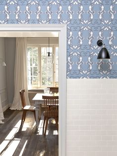 """Chrapka doesn't shy away from busy designs, whether a traditional toile de Jouy or quirky styles like Georgia Horton's Lobster Quadrille, used in this kitchen. """"You don't see the lobsters on first sight, just the arabesques,"""" she says. Even classic stripes are fair game. """"If the idea is fresh and innovative, no pattern is overdone."""""""